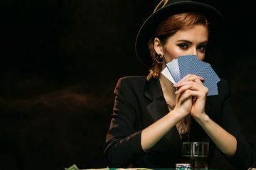 Gambling Poker with beautiful woman